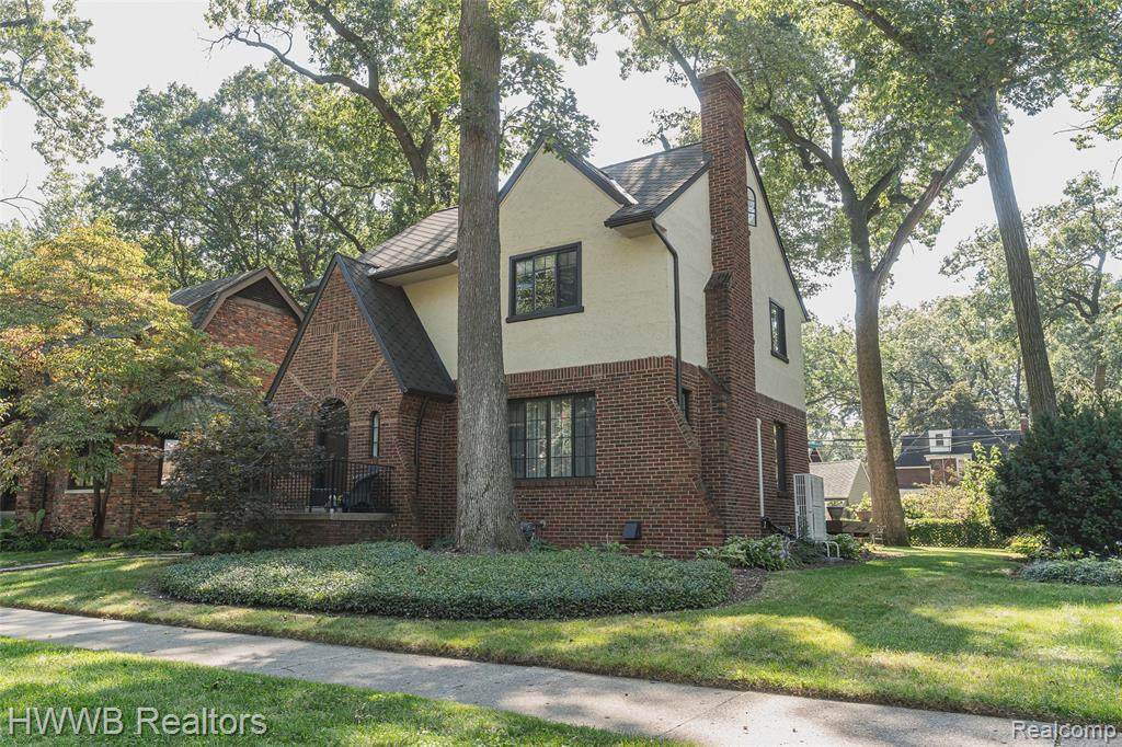 """This wonderful brick/stucco Tudor is in the sought-after NW Ferndale area on a tree-lined, distinctive street. This house was restored and enhanced keeping the original architectural style in mind. Newer roof with vintage look shingles, windows replaced, exterior stucco re-coated. Many interior updates including """"French gray"""" wider plank wood floors on the main living space. Updated kitchen with premium Kraftmaid cabinets with pull-outs, quartz counter tops and quality stainless appliances. Both bathrooms updated. Blown-in insulation on the second floor exterior walls. On-demand hot water; Tank-less. Finished lower level with wet bar; additional work/entertainment space. Third floor offers potential for expansion. Double French doors off the dining room leads to new composite deck for enjoying your pleasant backyard. Two car garage and fenced yard.  Don't miss this move-in ready, well cared for home."""