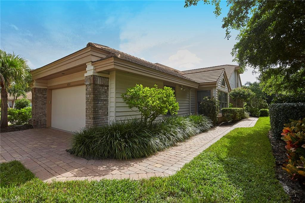 This bright and sunny, beautifully updated, one-level end-location villa in Pelican Bay is in move-in condition. The interior is well-designed with open-concept living and offers a soft contemporary flair, including wood floors, vaulted ceilings, skylights, plantation shutters and a newer kitchen, baths and atrium. Split floor plan with both a formal living room and family room, formal dining room, an eat-in kitchen and enclosed sun porch perfect for a den or garden room. The private location is a gardener's delight, surrounded by mature plantings and vegetation with a large open terrace. Double attached garage with storage cabinets. Enjoy the community pool and all the world-class amenities Pelican Bay offers.