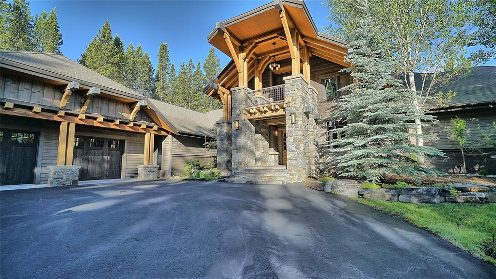 This spectacular home situated in the exclusive and private subdivision of Grey Drake, offers stunning views of the mountains, mature trees and ultimate privacy.  Abundant wildlife including Moose, Elk and Deer grace the property and provide a tranquil connection with nature as you drink coffee or sip fine wine on the extraordinary outdoor and private living spaces.  The proximity of this home offers unrivaled access to all Big Sky's outdoor adventures- alpine skiing, cross country skiing, snowshoeing, hiking, biking, golf and much more! With over 5600 square feet of furnished living area and extensive landscaping this home is the perfect location for a quiet retreat and entertaining family and friends.  Privacy, expert craftmanship and proximity define this home and you're just a short walk to Big Sky's Town Center and its variety of restaurants, shops and much more!  Adjacent lot, immediately south, can be purchased as well, creating over 4 acres combined in the heart of Big Sky.