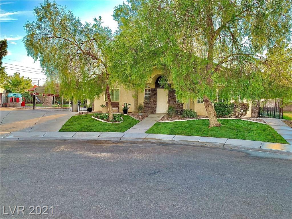 Don't miss this Rare opportunity to own a FANTASTIC CUSTOM HOME on almost 1/3 acre Cul-De-Sac lot! *On the edge of Summerlin without the fees!* Home is 6 Bedrooms, 4.5 Bathrooms, 2 Large Family rooms, OPEN CONCEPT living but has the privacy you want for the other living spaces. 2 Master bedrooms, plus 4 other bedrooms + OFFICE that has 1/2 bath attached. High Volume Cathedral ceilings in Living and Family rooms. Vaulted ceilings in Dining, Office, Master and even most other Bedrooms as well giving an open and spacious feeling throughout.  HUGE corner cul-de-sac lot with RV Boat parking, 2 car covered carport, and of course a MAN CAVE workshop area! The backyard has a PARK LIKE SETTING with sunken trampoline and Kid climbing FORTRUSS / play gym right in your own backyard!  Amazing outdoor living spaces to add to the incredible indoor living spaces! DONT WAIT! This property will go FAST, so call and book your showing NOW!!!