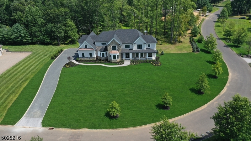 A 6,000 square foot home is being masterfully constructed, perched on the top of the hill, in one of the most sought after neighborhoods in Warren.