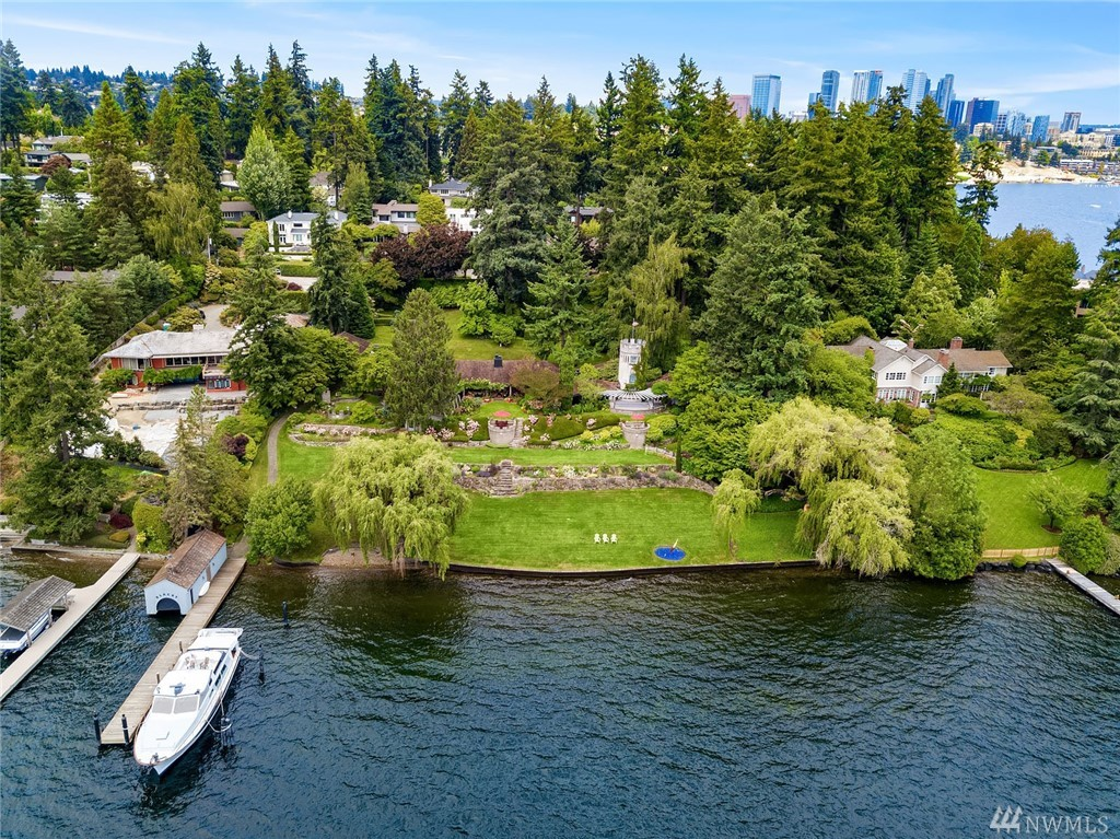 One of Medina's finest waterfront estates is offered for the first time in nearly 50 years. This is a once in a lifetime opportunity to purchase 280 feet of prime, southwest facing, no bank Lake Washington waterfront. Just shy of 2 acres, this exceptional property features rolling lawns and gorgeous gardens and offers views of the Seattle skyline and Olympic Mountains. A meandering lane leads to the privately sited home and grounds featuring a dock with deep water moorage, rare boathouse & lift.