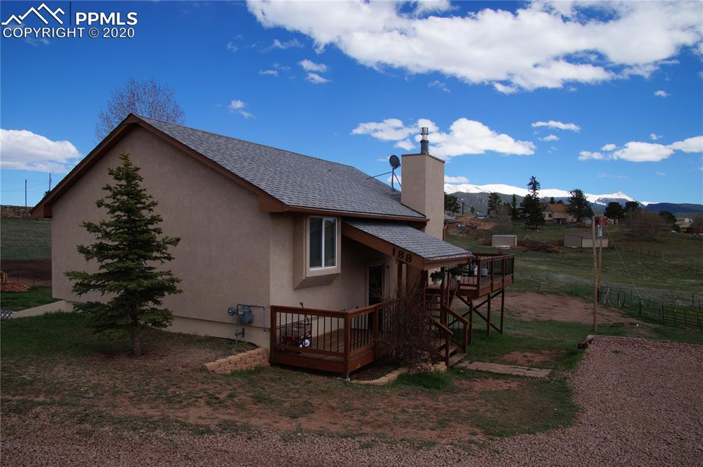 Great country home in the mountains! This well maintained home sits on 2.19 acres, has 3 bedrooms, 2 baths, views of Pikes Peak and room for you to spread your wings! Walk into your great room, with vaulted ceilings, and huge windows to let the warm sun in and the amazing views of America's mountain, Pikes Peak! The main level has the living room with gas stove for those chilly winter nights and the large, eat in kitchen. The master bedroom, a full bath, and an additional bedroom are also on the main level.
