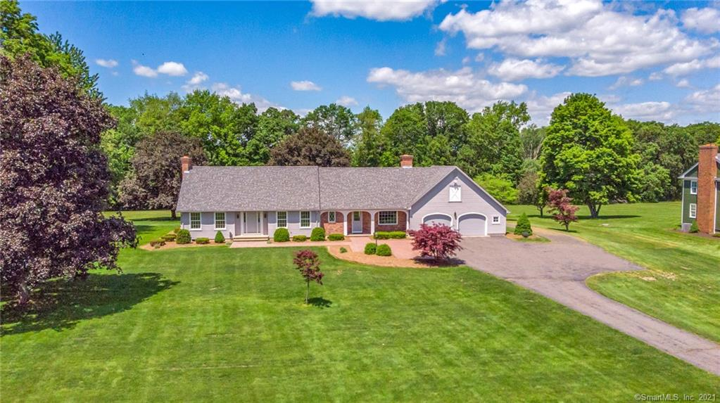 Classic New England Cape Cod.  Custom built and Impeccably maintained.  Set far off the road and backed to open space with conservation land also across the street.  Family room has custom exposed beams in the ceiling and 10ft wide raised hearth brick fireplace.  Family room opens a mud room/laundry area and full bath before entering the eat-in kitchen with lots of natural light.  The formal living room also has a 8ft fireplace.  Den/bedroom also on the main level.  Upstairs features two generous bedrooms, and a full bath.   Attic space is currently unfinished but has potential for expansion of living space and is framed to incorporate a second staircase.  The grounds and landscaping are beautiful.  There is a 20x21 covered concrete patio in the back yard.  The home has an attached two car garage and there is a 24x48 detached garage that has utilities and is fully finished inside, Collectors and Hobbyists take note! Siding, trim, and roofing all recently replaced in the last three years.  Special Property! Additional separate buffer parcel .73acres to the South is not included but could be available if buyer were to be interested.
