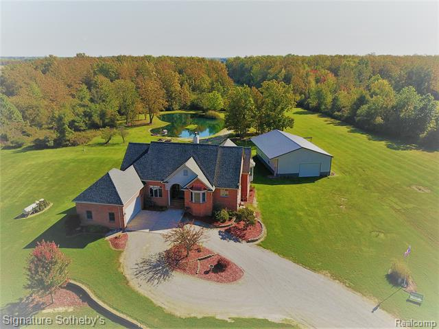 Your private airport--1/2 mile lit and licensed runway, 40'x60' hangar, 24.6 acres, pond and home for many purposes! (2770' with additional 2010' in finished walk out. Marble entry, pillared formal dining rm, wall of windows, cathedral ceiling, 2-way gas or wood fireplace+new wood floors in Great Rm. All new SS appliances in granite kitchen w/center island+eat at counter. Sunny breakfast area. Master bedrm suite w/sitting area, walk in closets, new granite separate sinks, tub+separate shower. Two more bedrms+dual entry bathrm. Guest half bath with marble floors. First floor laundry. Lower level is where the fun begins-dance floor, bar, hot tub, game room w/fireplace, sauna, storage and storage! Outdoor kitchen on spacious deck. Lower level patio. High garage ceiling and door. Spring fed pond with fish. Extra strong Hanger could be used for many purposes besides private airport--antique cars, horses, boats--your call! Whole house generator. Shingles 5yr. Turkeys+deer on property.