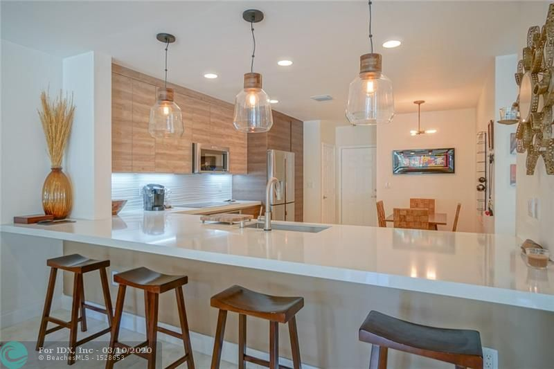 Amazing showcase ready townhome with OCEAN ACCESS deeded dock space has been immaculately designed & tastefully finished. This beautifully refined home has been upgraded with high end finishes throughout. Custom finishes from top to bottom- enjoy your chef's kitchen fully equipped with stainless steel appliances & custom organizers. The open concept living area is filled with natural lighting and flows out to your secluded patio. Each bedroom features built out closets. But wait, there's more! This home comes fully equipped with smarthome security & automation. Enjoy the South Florida Lifestyle with dock space, a marina, and community pool only steps away from your front door. RARE OPPORTUNITY !