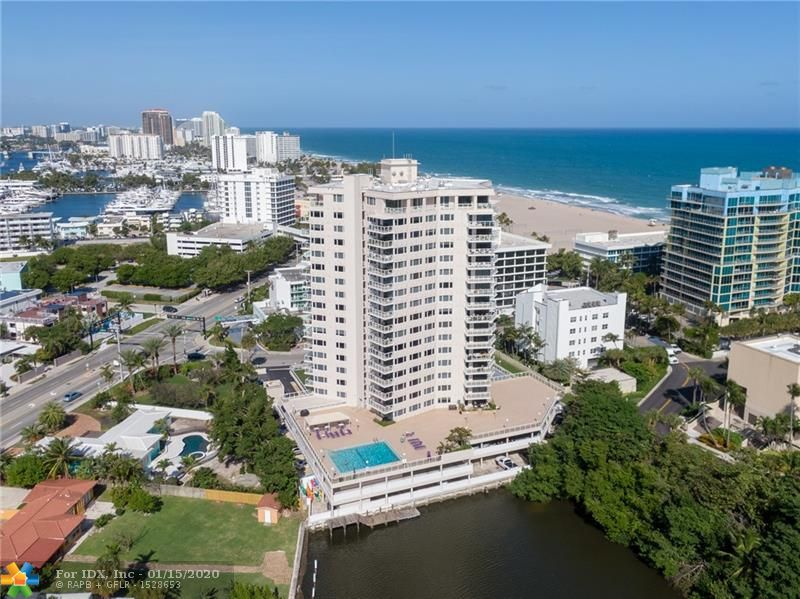 Exceptional 1 Bedroom / 1 1/2 Bathroom Condo in the center of the popular beach resort district! This corner unit has been totally remodeled...Beautiful views of Lake Mayan and the pool deck.  Included in this model are impact windows and door, washer and dryer.  The lobby and common rooms are going to be remodeled and has been paid out of the building reserves.  This amazing unit is priced to sell fast!!