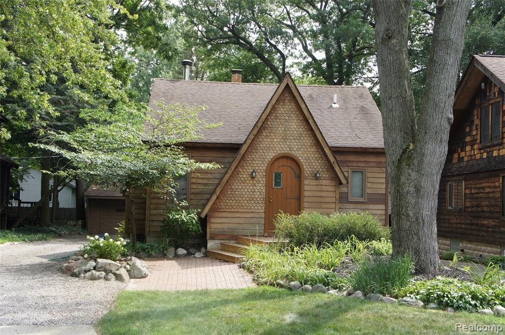 Wood craftsman home in beautiful Sylvan Lake, MI.  3 bedrooms, 2 baths, with detached garage, western cedar siding, vaulted ceilings, wood burning stove with floor to ceiling fieldstone hearth, second story master loft with redwood deck with swing.  Tile flooring from the Stroh Brewery. Sears kit home built in the 1920's, completely renovated by a craftsman in the 1980's.  Words are inadequate to describe the beauty and uniqueness of this home.  Plus lake privileges to all-sports Sylvan Lake and community parks, beaches, and club house.