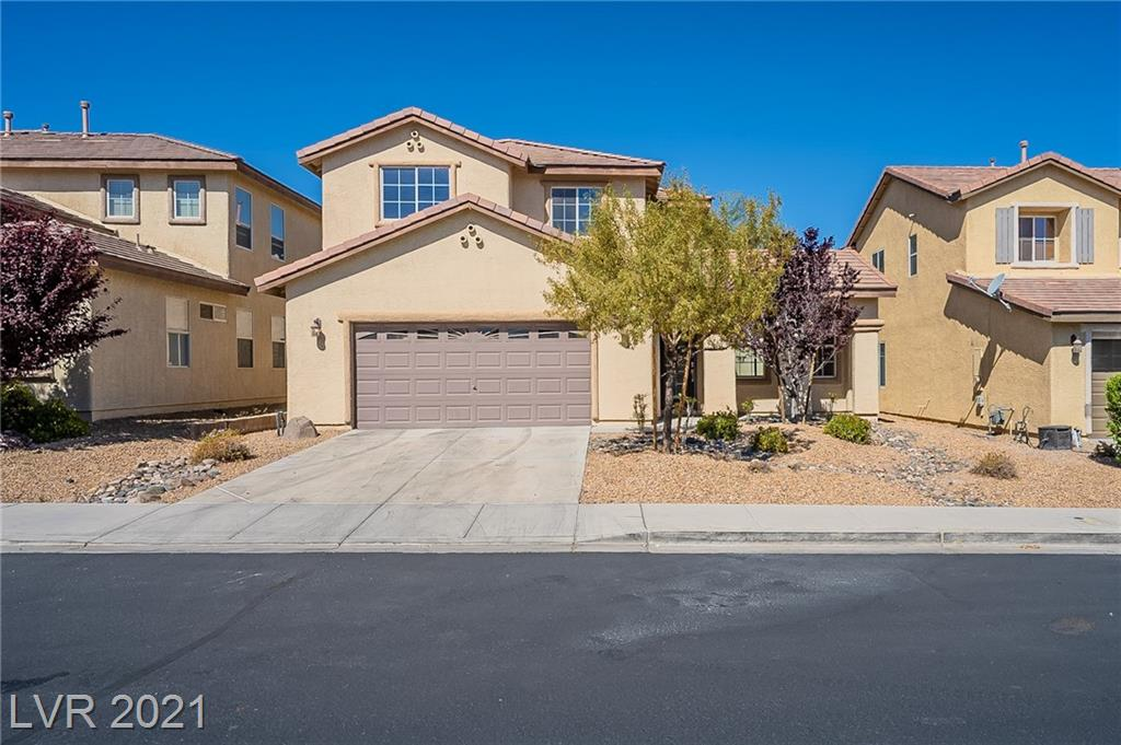 This Henderson two-story home offers granite countertops, and a three-car garage.