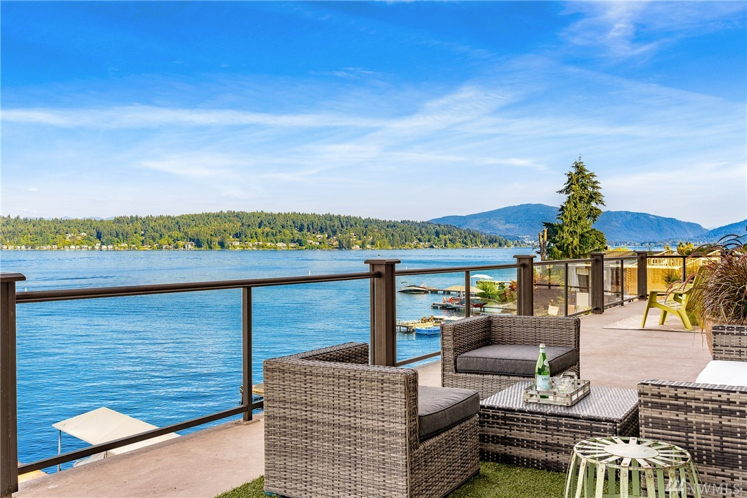 Find your way home to luxurious Bellevue lake living,3 levels of expansive lake views, 115' of no bank waterfront w/dock & boat lift. this waterfront gem has it all. A grand entry w/water feature invites you to enter and bask in the views, three large decks entreat you to sit and enjoy the sun and all the lake has to offer from this prime West location, close to Microsoft Google Costco I-90 and minutes from DT Bellevue schools. 2008 built, freshly updated paint, carpet I/O buyer to verify