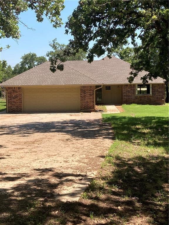Beatiful brick home on 2 1/2 acres.  Newly remodeled features include: new granite counter tops, kitchen cabinets, stainless appliances, roof, garage door, high efficiency heat and air with heat pump, fixtures,and flooring, plus more!