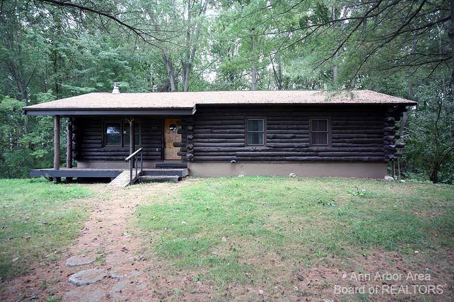 Secluded and peaceful wooded setting, this full log home is situated on 15.50 acres between Gregory and Pinckney. 3 bedrooms, 1 full bath, 9 foot basement ceilings. Large pole barn and smaller shed. Deer, turkey and other wildlife abound in this serene rural setting.