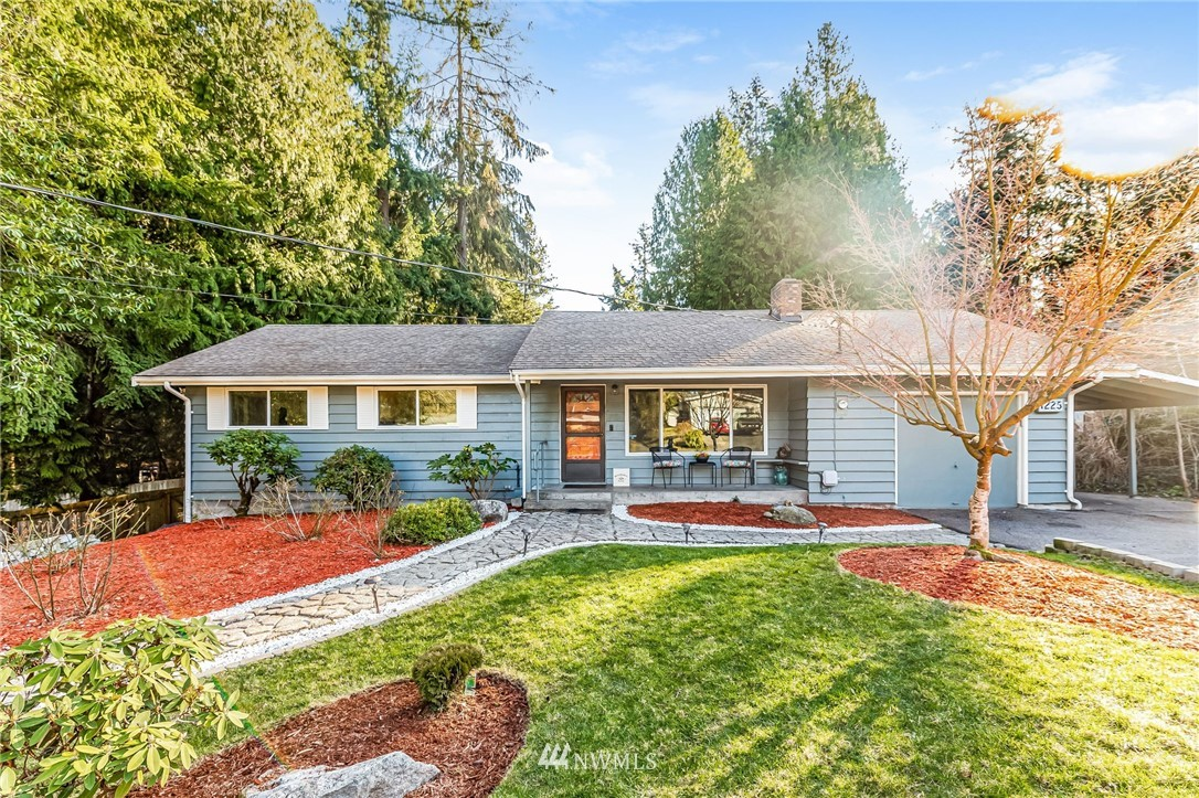 This home offers you an abundance of privacy with just over ¾ of an acre (37,620 sq ft). 3 beds, 1.5 baths, 2,660 sq ft of open concept living, spacious dining, and kitchen areas warmed with a gas fireplace. Large lower level bonus room and 2 other rooms for storage or office space. Enough parking for a RV, boat or trailer.  Relax on the entertainment-sized deck where you can enjoy your garden views year-round and the peaceful surroundings of the neighborhood.  This home has everything you need! Great possible investment potential to possibly subdivide or put a DADU on back portion of the lot! Zoned RS15.0.