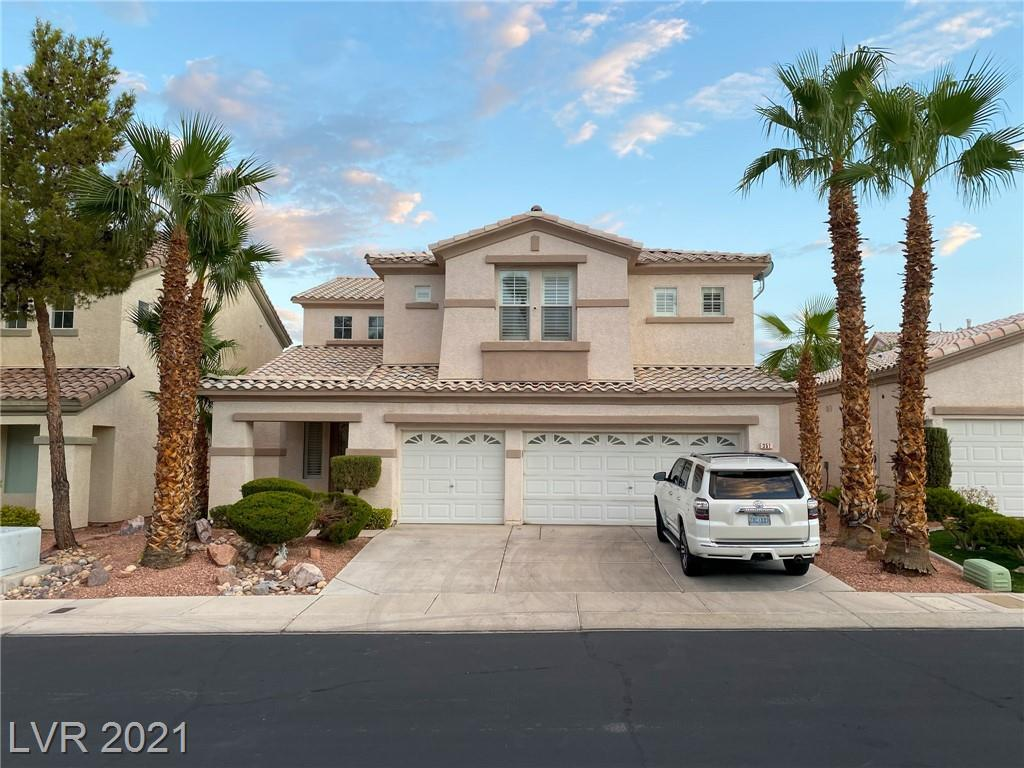 Beautiful spacious open floor plan w/3 car garage in guard-gated Rhodes Ranch.  Move-in ready and gorgeous.  Oversized master. Master bath w/double sink & separate tub and shower. No Carpet!! This home will not disappoint.