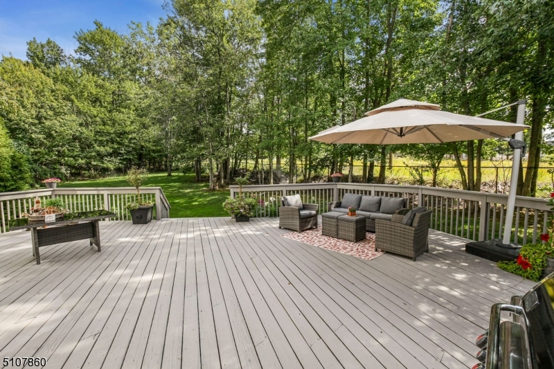 Welcome to this lovely chic and contemporary home, set on incredible sized lot in exclusive Laurel Hills!. This home is enveloped by vaulted ceilings and dramatic architectural windows. This 5 bedroom 4.1 bath stunner offers maximum comfort and features bright and airy spaces with inviting ambiance perfect for everyday living. First floor offers elegant grand entrance foyer, a great room, family room, a bonus versatile home office space, formal dining room, guest suite and custom Poggenpohl kitchen. Second floor offers an awe-inspiring primary bedroom suite with a walk-in-closet and 3 other generously sized bedrooms. This home offers great value and luxury living in Livingston NJ.