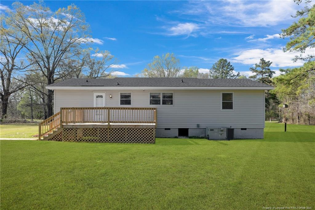 Sitting in almost an acre of land, this beautiful home features 3 Bedrooms and 2 baths. Living room w/laminate flooring.Kitchen with eat-in area. Master bedroom with full bath includes tub. Large deck overlooks huge yard! You MUST see this home!   * RENOVATIONS IN PROGRESS *