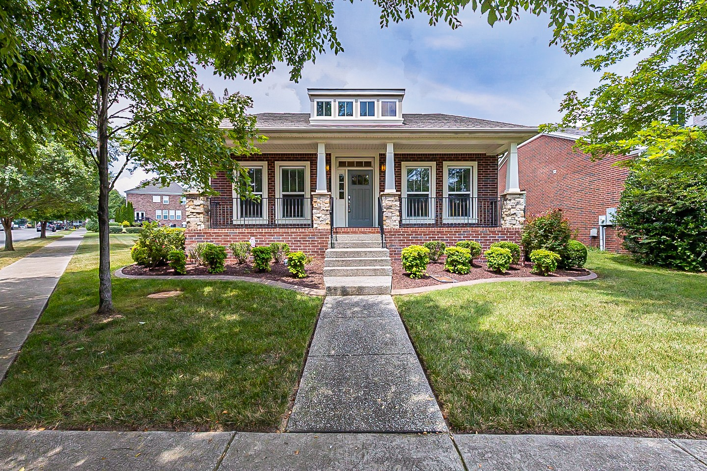 This Franklin one-story home offers granite countertops, and a three-car garage.