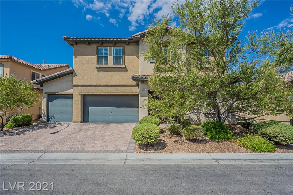 This Las Vegas two-story home offers a patio, granite countertops, and a three-car garage. This home has been virtually staged to illustrate its potential.