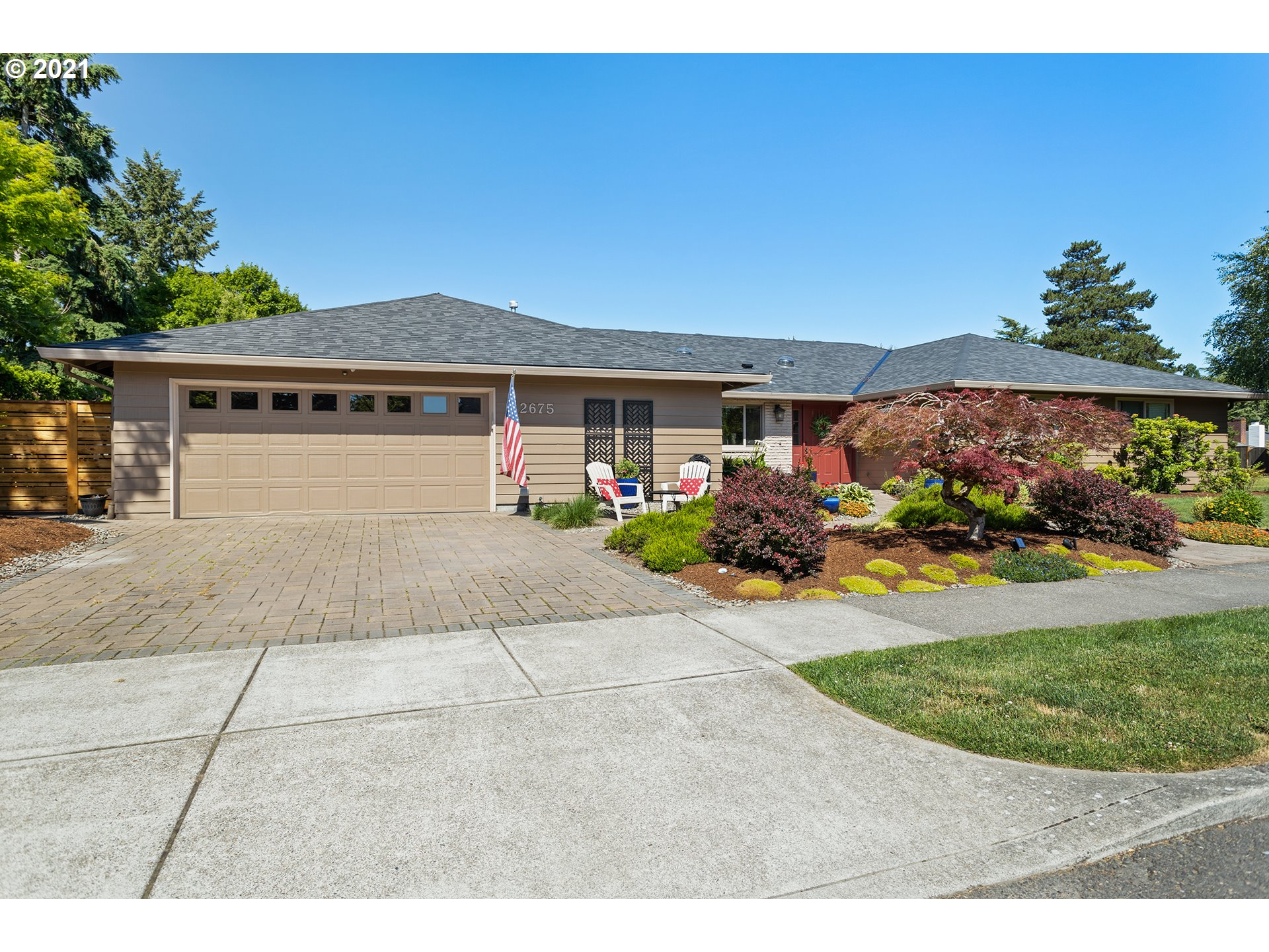 Desirable Oak Hills one level beauty!  2446 sq ft w/4 bedrooms + 2 full baths on one side of floor plan & 5th on other side w/full bath. Open floor plan for living room, dining room, family room & kitchen.  2 new brick fireplaces & vaulted ceilings in living room.  Slider off family room to covered patio. New fenced yard w/artificial turf, hot tub & patio areas, next to greenbelt. New swim pool & clubhouse and play & recreational areas as well as walking trails & athletic fields in Oak Hills.