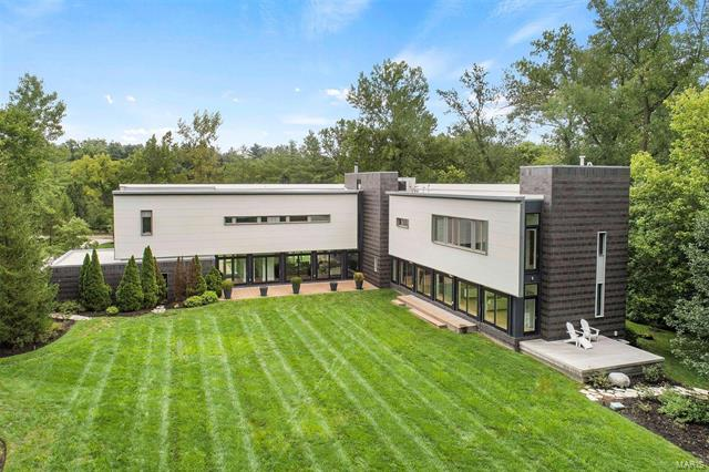 This newer, custom-designed contemporary home by a Boston architect is a dramatic masterpiece. This dynamic house is open, bright and sophisticated. The living room has a 2-story ceiling, wood burning fireplace and doors that lead to the back deck and private yard. The kitchen has European cabinets, 2 dishwashers each with 2 drawers, 2 refrigerators & freezers, gas & electric stove with wok burner & 2 ovens. Off of the kitchen is a family room, craft room/office and gym. The master suite is separate from the other bedrooms creating a special retreat. His and her walk-in closets. The master bathroom has a jacuzzi tub,  separate shower and dual sink vanity. The other wing of the house is great for your family or guests with three bedrooms, laundry room, computer work area and 2 full baths. Beech hardwood flooring throughout the 1st and 2nd floors. The lower level features two recreation rooms, full bath, office and plenty of storage.  Tennis court. 3.47 acre lot that backs to woods.