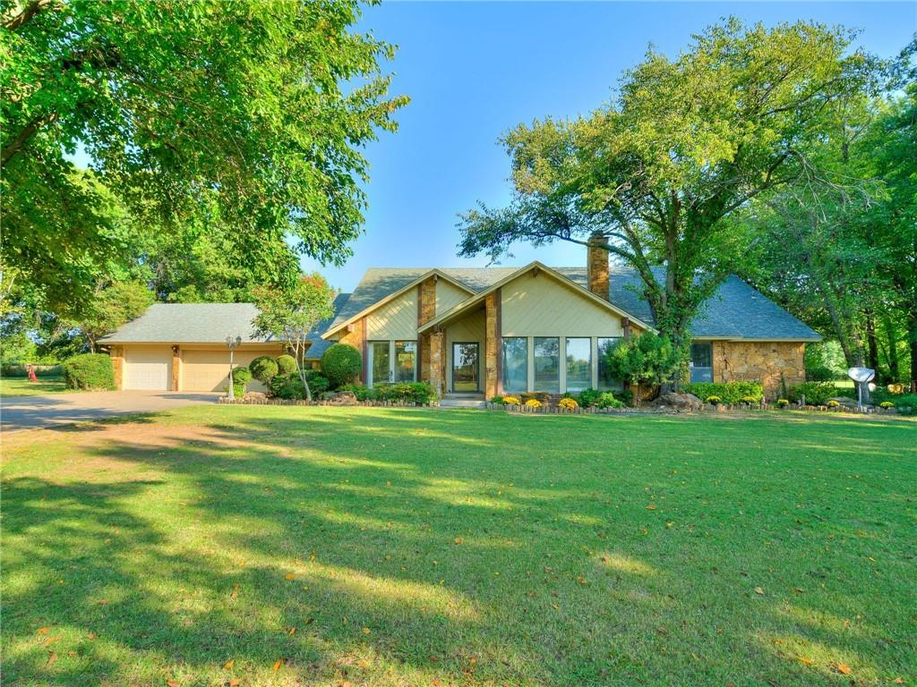 """PRICE REDUCED!!! A Beautiful Rock house with a park-like landscape, sitting on 5.00 acres MOL in Oklahoma City limits & Moore School District plus super close to the Will Rogers World Airport!!!  I can hardly believe it myself...  This home is well maintained but could use some updating.  The land has many mature Crape Myrtles, Pecan & Sycamore trees.  There are 4 wells on the property, 3 for the land/irrigation & the other is for the house.  A workshop is at the northeast side of the 5 acres.  Property to be sold in """"as is"""" condition but Seller is willing to complete Appraiser required repairs.  Schedule your showing today!"""