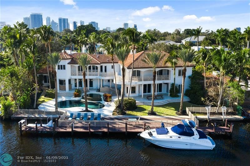 You have arrived at 112 S Gordon Road. This 7,388 SF waterfront estate is walking distance to Las Olas Blvd, the most coveted street of fine eateries and shopping in East Fort Lauderdale, sitting on an assemblage of three lots covering approximately 1/2 acre of property, 154 feet of deepwater frontage with no fixed bridges, and 117' of dockage. Navigate your yacht with ease on the 255' wide canal with easy turning. Built in 2001, the property features all impact windows and doors, a resort-style pool with a summer kitchen, gym, a new 80KW generator, LED lighting, sound system, a separate entertaining wing with a wet bar, and two master suites. Seek paradise and live the Fort Lauderdale lifestyle.