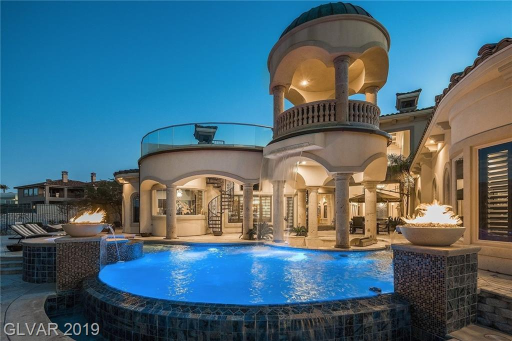 This masterpiece built for entertaining sits in guard gated Terracina and is on the 9th Fairway of Rio Secco Golf Course. Exquisite finishes throughout. Entertain with breathtaking, 360 degree panoramic views of the City, Desert, Strip and Golf course from the spacious back yardsunken built in kitchen area, infinity edge pool, private view terrace. Includes Smart Home, Wine Room, Home Theater, Entertainment/Game room with 9tv's & Lovely Kitchen.