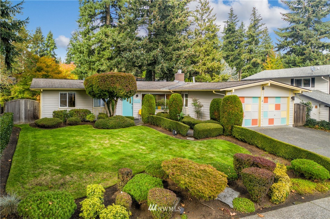 Light, bright, sunny & open describes this groovy Kingsgate mid-century home. Gleaming hardwoods, oversized windows & cozy gas fireplace welcome you through a distinctive front door while Michelin worthy Chef's Kitchen nods to relaxing great room & outdoor spaces filled with topiary treats. 3 beds & 2.25 baths including master suite. Too many updates to list! Oversize garage w/ 220v & pre inspected! Community park w/ swimming pool, and minutes to Totem Lake shopping & restaurants. Welcome Home!