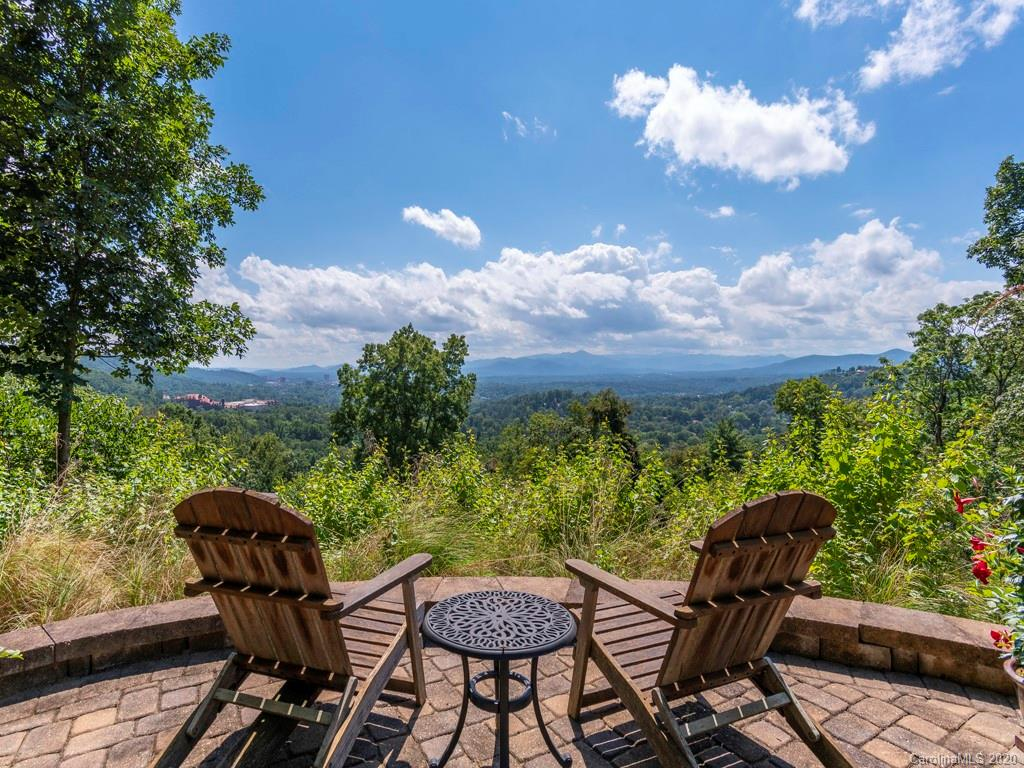 Rare opportunity in Grove Park to own secluded, three home family compound on two acres with incredible views that include Grove Park Inn, downtown Asheville & western mountain ranges. This property has never before been offered publicly with current owners having 45 years in residence. At 2800 square feet, main house offers four bedrooms, 2.5 baths w/spectacular views from gourmet kitchen, adjacent dining room, living room & master bedroom. Enjoy several outdoor seating areas including patios, decks & garden area, or just sit in the hot tub & watch the sunset. Two bedroom, two bath second home on property provides options of caretaker or in-law residence, rental income or guest cottage. But wait, there's already 700 square foot guest cottage that could also serve as home office. All of this is less than 10 minutes to DT Asheville in the heart of one of Asheville's most sought after neighborhoods. You could look a long time but it's safe to say, there is nothing like this out there.
