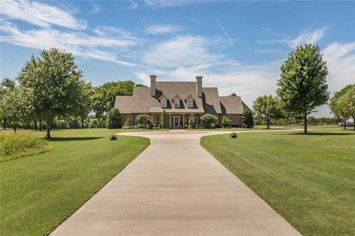 This 40 acre estate located in Deer Creek is one of a kind! A private gated, tree lined entry greets you just steps away from the convenience of highway 74. The colonial style 6 bedroom 3.5 bathroom home is custom built and has plenty of space for your family. The highlights include new carpet in the bedrooms, an office, 2 dining areas, a living room overlooking the heated pool and a basement complete with a snooker table! Additionally, there is attic space that is floored/plumbed and ready to be finished out for an extra living, bedroom & bathroom with it's own separate entrance. The outdoor entertaining space includes a heated pool overlooking the vast acreage, full size baseball diamond and a 42'x60' Morton shop building. This true treasure is ready for you to enjoy the quiet of the wildlife within minutes of the city!