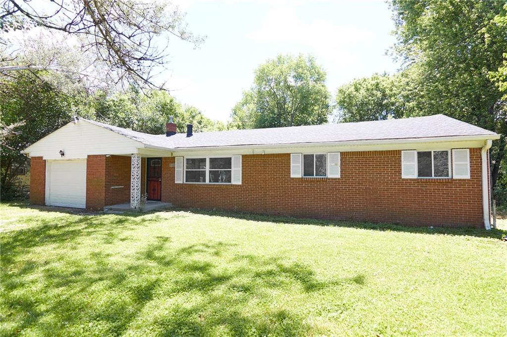 This spacious brick ranch is located in a quiet neighborhood on the East side of Indianapolis. It offers a large yard (almost 1/2 acre) with mature trees, 3 bedrooms, 2 full baths, eat-in kitchen open to the family room, a separate living room, and almost 1,900 sq ft. Features and updates include: new carpet and paint throughout, new roof 2019, wood floors in the living room, walk-in closet in the master, wood deck, a 1 car attached garage, and a 2 car detached garage and shed for additional storage space. Don't miss out on this great opportunity!
