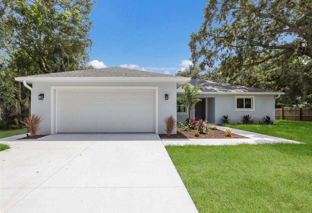 Wow. Most affordable new construction home opportunity in Sarasota! The CO is in, so it is ready for occupancy or use as a weekly rental as it is located within city limits. This home features delightful everyday luxury, top quality craftsmanship, and stylish design. All windows are impact glass, so no need for storm shutters. As you enter, you will be welcomed by wide open living, soaring ceilings, and durable waterproof laminate flooring. The open concept kitchen offers ample white custom cabinetry, granite countertops, Samsung stainless steel appliances, pantry, and island where the whole family can hang out. A set of French doors from the dining area lead to a covered lanai with epoxy floors, perfect for relaxing or al fresco dining. The home has an exterior shed building that is in great condition with the potential to add on for an ADU opportunity and the yard perimeter is fenced. The spacious owner's retreat offers a personal sanctuary with double vanities, glass semi-enclosed walk in shower, and large walk-in closet. Two additional bedrooms offer a cozy guest accommodation and a home office with easy access to the second full bathroom. A covered front porch, interior laundry room, and epoxy garage flooring finish off this home perfectly.