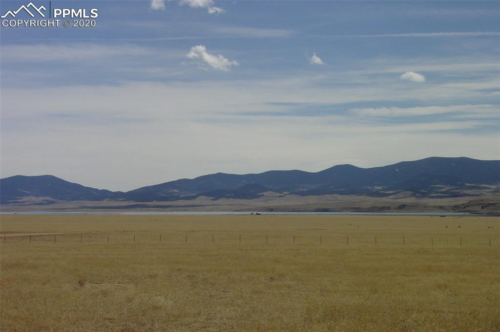 """Puma Hills Addition to High Chaparral Ranch has incredible views plus Eleven Mile and Spinney Reservoirs in your front yard. Zoned AG so camping is still OK. Hunt and fish the Colorado """"Dream Stream"""" South Platte river, gold medal catch and release!"""