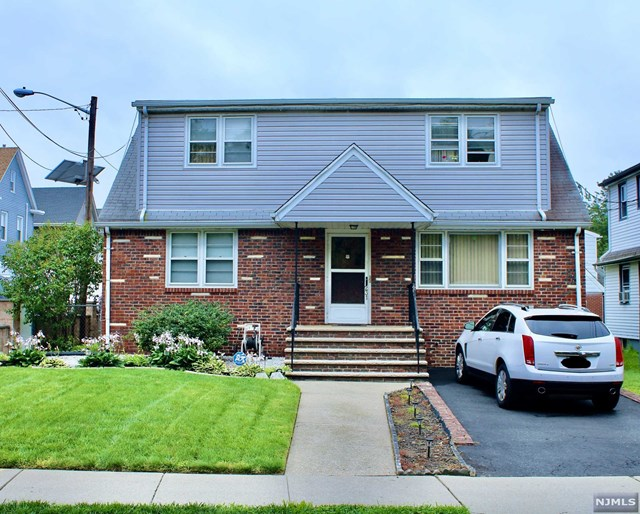 """LARGE TWO FAMILY HOUSE WITH FINISHED BASEMANT, EACH HOUSE FEATURES 2 BEDROOM, LARGE LIVING ROOM, BATHROOM, KITCHEN AND CENTRAL AIR. LONG DRIVEWAY. HOUSE BEING SOLD """"AS IS"""""""