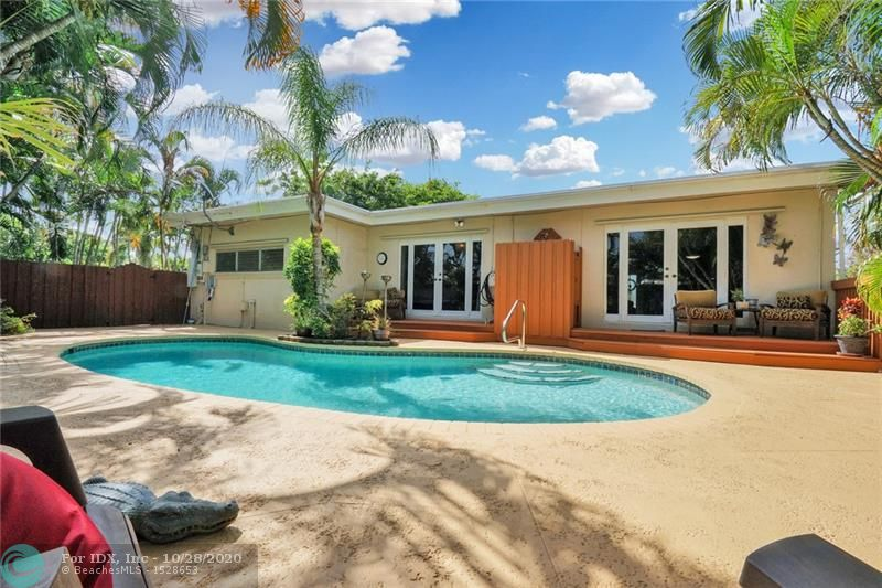 Prime Lloyd Estates pool home. Tranquility & privacy abound in this unique home. The kitchen & baths are second-generation remodel, featuring granite counters & stainless appliances.  Polished concrete floors, split bedroom plan for added privacy. The living area and master bedroom w/ walk-in closet is at the back of the home &  both have sliders leading out to the tropical paradise,  pool, and outdoor shower. The attached but separate family room is a mother-in-law studio with its own full bathroom & full kitchen- So the home is really a 3 bedroom 3 bath. Roof 2005, AC 2009, AC air handler 2017, water heater & pool pump 2016. Walk to Crunch gym shopping center and a 3-minute drive to the shops of Wilton Manors and a few minutes to the beach. Tenants pay $2400 +$800=$3200 mn on m-m lease