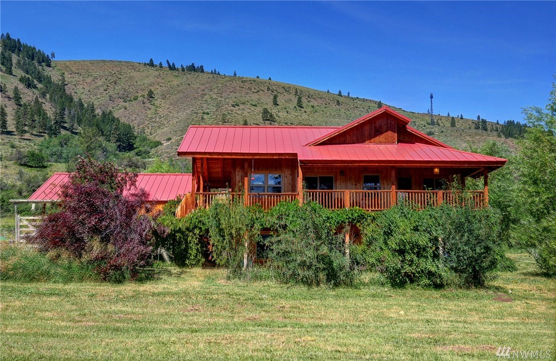 Ideal custom home on 6 acres! Part of 1895 Homestead! Convenient location only minutes to Winthrop & schools. Well designed floor plan w 3bd/3bath, office, 2,184 sq foot finely crafted home. Quality construction throughout! Creative use of tile, wood & stone. Master suite w exterior entry. Wrap around covered porch w sweeping valley & mountain views. Idyllic sunny setting w fruit trees & lilacs. Low carbon footprint w solar panels & radiant heat floors. Includes garage & irrigation shares.