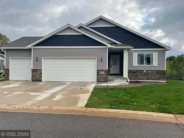 Walkout basement backing up to nature area, granite tops thru out, custom cabinets with island, vaulted ceilings,large laundry/mudroom,walkin pantry,triple garage, concrete driveway,deck. $100 association reserve required at closing by association.