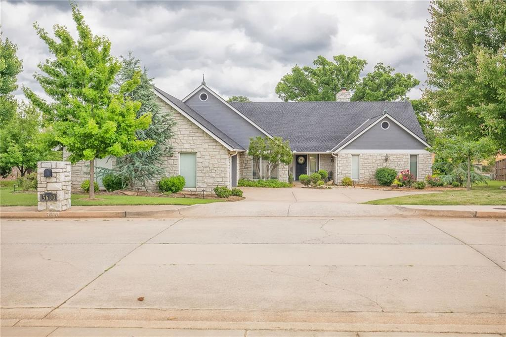 This beautiful home sits in Edmond's premier gated neighborhood of Oak Tree with serene landscape. 5600 Irvine Dr. is a comfortable single story home with a well-designed layout featuring spacious rooms and tons of storage. Living room is gorgeous with rich wood beams, vaulted ceilings, stone fireplace and built-ins. Kitchen is open to the breakfast area and 2nd living and includes stainless appliances, granite and wall of windows and glass doors. Dining room will hold over-sized furniture. Two big bedrooms with walk-in closets, full bath and utility room round out one side of the home. With a split bedroom plan, the master has its own wing including gorgeous stone fireplace, sitting area, and custom sunroom. The neighborhood is home to Oak Tree Country Club with championship golf and first-class amenities such as restaurants, tennis, fitness center, Olympic-size pool and social events. No other Edmond country club offers the blend of amenities and atmosphere.