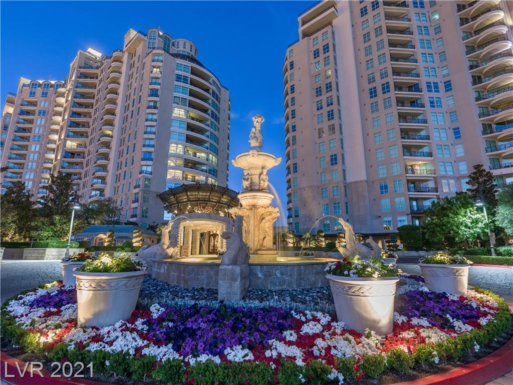 Welcome to the ideal two-bedroom at Queensridge Place, with private elevator vestibule, plentiful entertaining, office, two terraces, and views of the mountains and Las Vegas Strip. The formal dining room lends gravitas to the stone-inlaid circular foyer, while accommodating a wet bar and wine refrigeration. An expansive great room defines this comfortable unit, with built-in media cabinetry and fireplace. The huge gourmet kitchen features copious cabinetry, the finest Viking appliances, breakfast bar and nook. The main terrace commands views of The Strip while framing your entertaining experience. The spacious and serene master suite includes a walk-in closet and mountain terrace, while its luxurious bathroom boasts a jetted tub and steam shower. A guest suite is complete with its own bath, walk-in closet and terrace. The study features a gorgeous built-in desk and library. Private, covered 2-car garage. View the video to be amazed by the rarified lifestyle Queensridge Place provides!