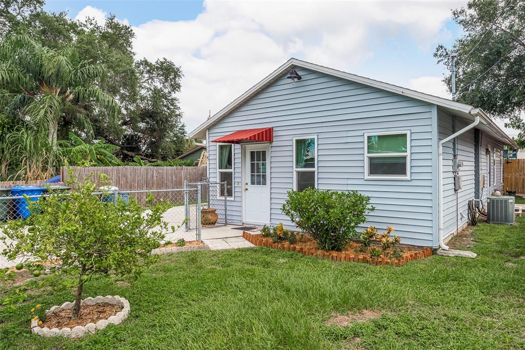 """JUST DARLING! -- Make your appointment today to see this CHARMING 2-bedroom, 1.5 bath POOL home nestled in the heart of downtown Largo. Highlights include a bonus or """"flex"""" space upon entry (currently being used as an office space!), a spacious open floor plan, a MASSIVE kitchen featuring beautiful Terra Cotta-style floors, indoor laundry and a large living room perfect for entertaining. The primary bedroom features an en suite bath and tons of storage, while the second bedroom features two large closets and tons of natural light. The second full bath boasts DUAL vanities and is clean and pristine! But that's not all -- outside you'll enjoy the best of Florida sunshine in your SPACIOUS backyard and fiberglass pool! You'll also benefit from the large storage shed perfect for storing lawn tools and pool gear. Per the seller, new impact windows added, NEW CARPETS IN BOTH BEDROOMS (2021), roof is 2020, and the water heater is 2017/2018. PLUS NO HOA!!!! The best part? THE LOCATION! Live within minutes of top-ranked beaches, restaurants, shops and tons of recreational activities! With the surging cost of rent, why rent when you can buy? But HURRY, this one won't last long! ** This home currently qualifies for down payment assistance from the city of largo (restrictions apply). Ask agent about savings programs available**"""
