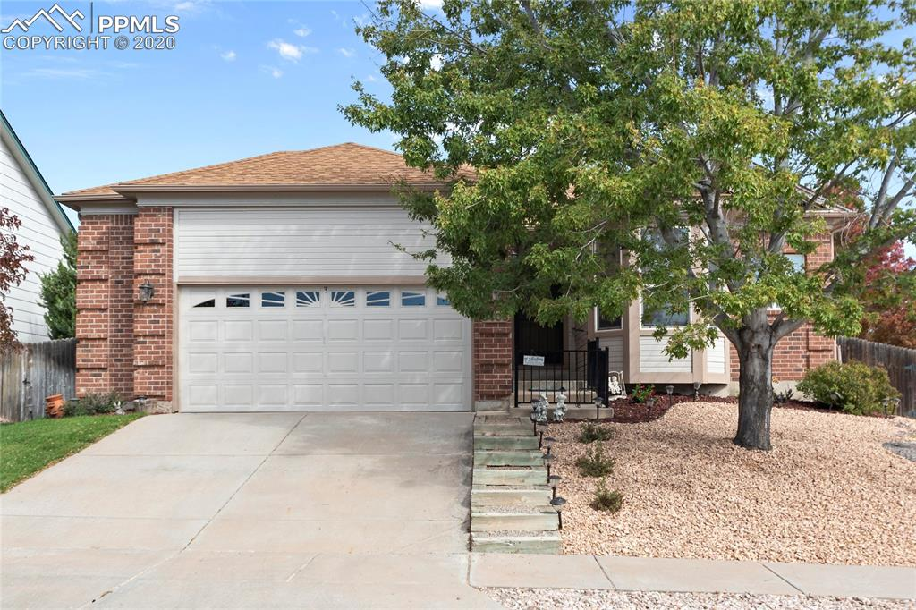Look no further than this Ranch style home with full finished basement. This 4 bed, 3 bath, 2 car garage gem sits in a prime location for shopping, District 49 schools, easy access to the highway 24, the Powers Corridor. and Schriever and Peterson military installations. As you enter, you are graced with vaulted ceilings and big windows that fill the room with bright, natural light, bringing an open flow and feel.