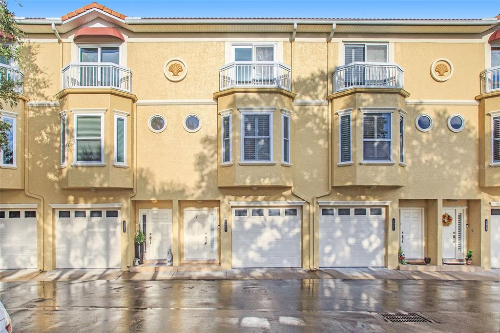 One or more photo(s) has been virtually staged. This Tierra Verde three-story home offers a two-car garage.
