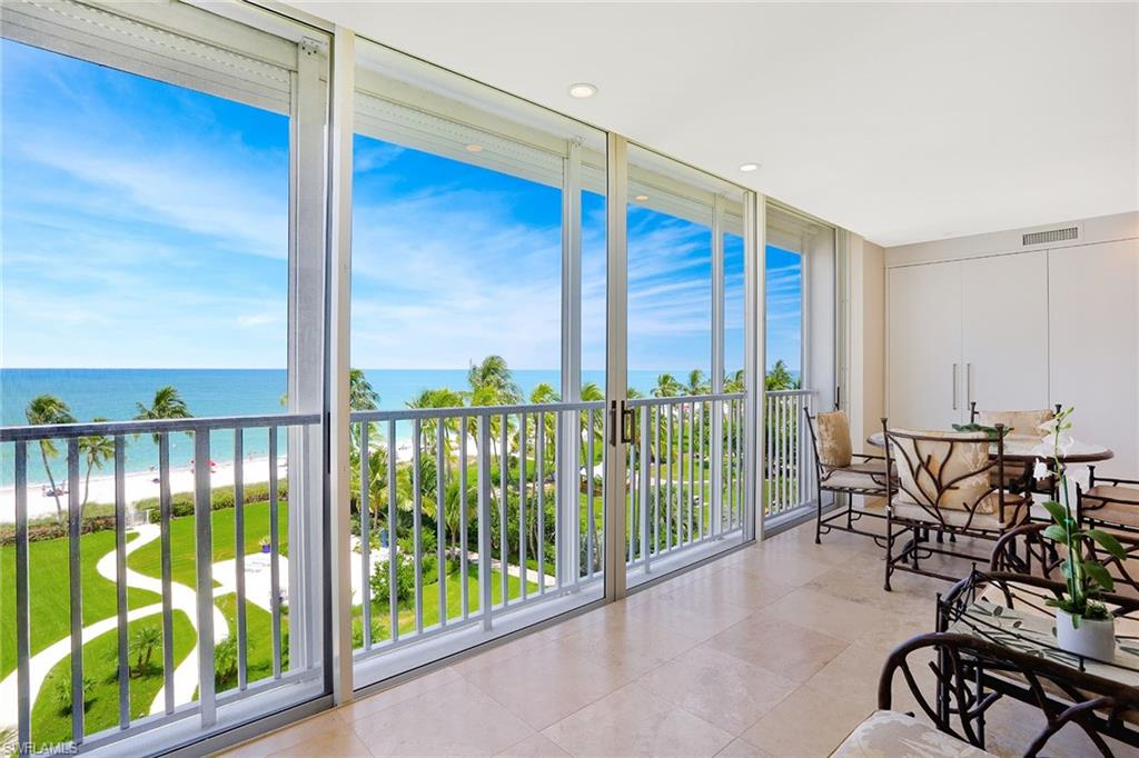Enjoy exceptional direct beach views from this sophisticated and timeless residence. Sited on the fifth floor, this 3,445 sq. ft., 4-bedroom, 4-bath condominium features updated and refined interiors with an open floor plan connecting the living spaces with nature's coastal setting. Natural stone and white oak hardwood flooring, a sleek and modern kitchen with custom cabinetry and high-end stainless steel appliances, spacious walk through pantry and extensive storage are just a few of the highlights of this exceptional home. The master en-suite with a spa-like bathroom boasts its beachfront sitting area and custom-designed walk-in closet. Three additional bedrooms, one with a covered balcony, offer flexibility and privacy for family and guests. Located on Gulf Shore Boulevard in Coquina Sands, this beautiful beachside home provides a gracious and quiet setting with on-site manager, community room, pool, and remarkable beachfront garden all within proximity to Old Naples' shopping and dining district.