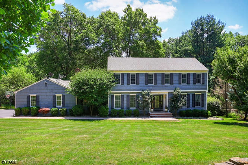 Outstanding Center Hall Colonial set back beautifully on a sweeping emerald green lot in a welcoming Mendham Borough sidewalk neighborhood-a nicely renovated home in one of NJ's most admired towns. 9 rooms, 2 full and 2 half baths, fireplace, renovated designer kitchen w adjoining breakfast room, fantastic family room, & marvelous master bedroom suite-this beautiful home offers a superb floor plan & seamless flow w over 2,880 sq ft of commodious living space on 2 upper floors, plus a fabulous finished lower level with walkout to brick patio, powder room & kitchenette. Expansive Trex two-tier deck and private, pancake-flat rear yard all combine to create a true backyard oasis. Two-car attached garage with paved driveway & ample parking. Professionally landscaped 1.7 acre showcase property .Move-in ready!