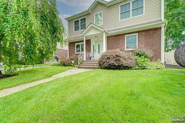 Beautiful home in desirable Bergenfield area. Living room, formal dining room, den, modern eat in kitchen with sliding doors to the backyard. First floor bedroom and updated full bathroom. Upstairs you will find the primary bedroom with en-suite bathroom and walk in closet. Four additional bedrooms and an updated full bathroom. The basement has a rec room, laundry room and lots of storage. Beautiful backyard to play or entertain. 2 zone central air and underground sprinklers. Close to houses of worship, parks, and shopping.