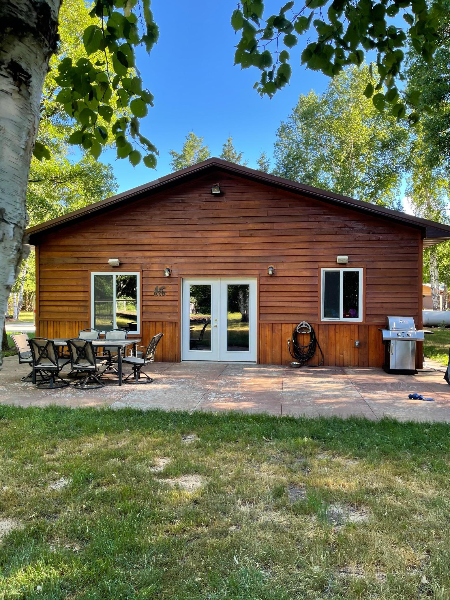 Take a look at this 2 bedroom country home on 2.8 acres in great location surrounded by lakes. Stamped concrete heated floors, custom woodwork, open floor plan, wet bar, insulated and heated shop/garage, bonfire pit, large fenced garden and storage shed. Sellers had horse in horse stall with electric fence running in the back of property, water hook ups in a few locations in the yard.
