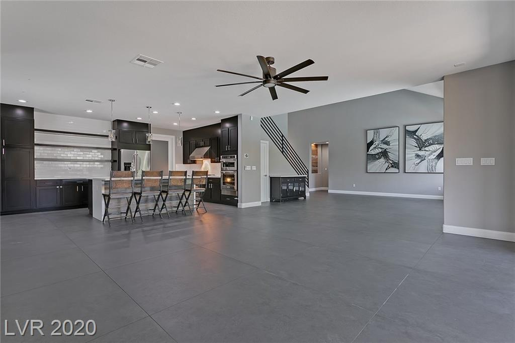 Stunning modern home in beautiful gated community. This home features a spacious open floor plan perfect for entertaining and a first floor master bedroom with a door directly to your private pool. Take the party to the backyard where you'll find a beautiful pool and spa, along with a covered patio, built in BBQ, and outdoor fireplace.