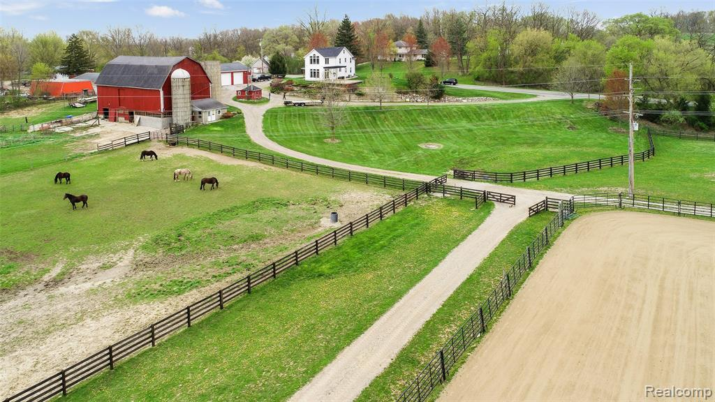 Rare opportunity to purchase 35 acres on a paved road, with natural gas, multiple outbuildings and a renovated farmhouse. The property offers many options with its wooded trails, fields for hay and/or crops and fenced pastures for animals. Outbuildings include a 60'x156' barn with indoor arena and 6 horse stalls, a 32'x64' shop with 1 ton jib crane, a 36'x84' 2 level hip roof barn with 5 stalls, milking parlor and ample storage. The renovated farm house has 3 bedrooms, 2 full baths and first floor laundry. This home has spectacular views of the property with wall to wall windows on both the first and second floor. A 115'x160' sand outdoor arena and a 50' round pen are great for equestrians. Just 12 miles from Michigan Stadium!! Too many features to list, visit the tour link to learn more. Truly a rare find in this area, you do not want to miss out on this one. Do not go to the property without an appointment.