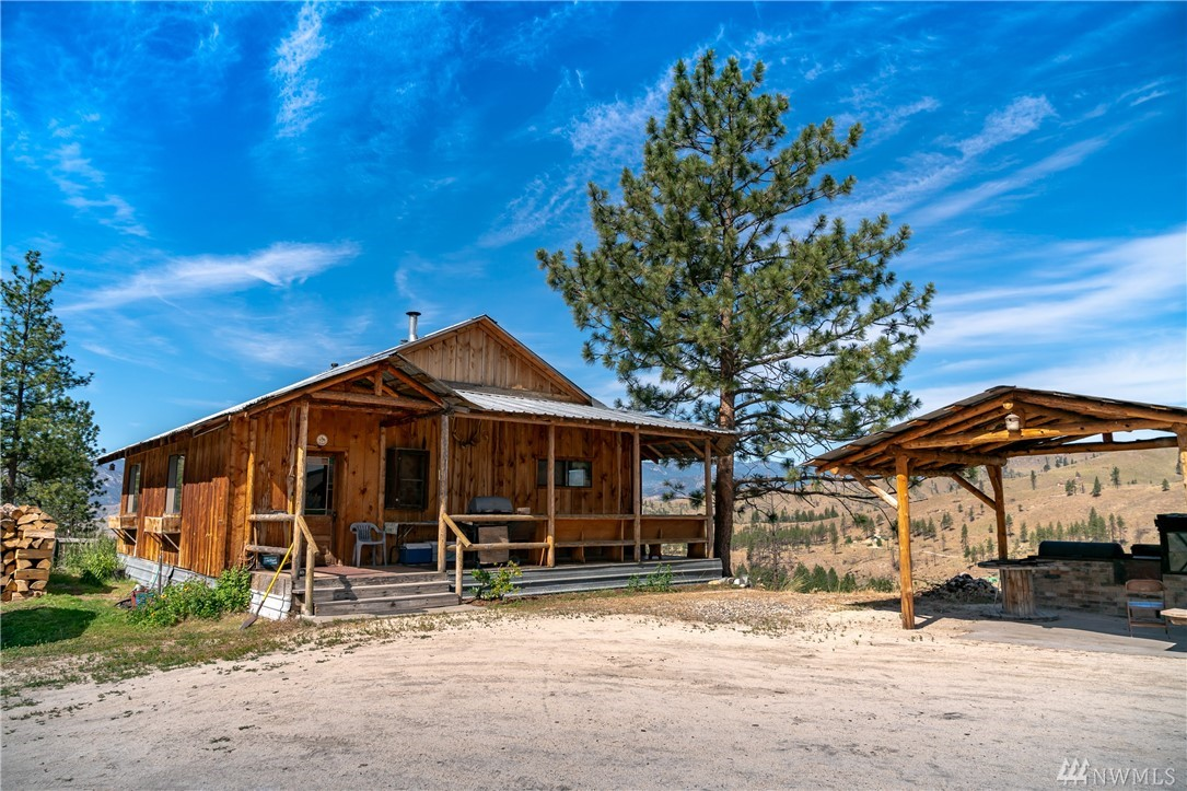 The quintessential off-grid homestead on 30 acres surrounded by nothing other than peace and quiet. Sit out on the covered front porch and marvel at the stunning views. Property offers main cabin, detached art studio, barn and outdoor kitchen. Absolutely charming interior with reclaimed hardwood floors, custom kitchen tile and cabinets and both wood burning and propane fre-standing stoves. Two bedrooms and one bathroom with additional finished room that could be used as den/hobby/office space.