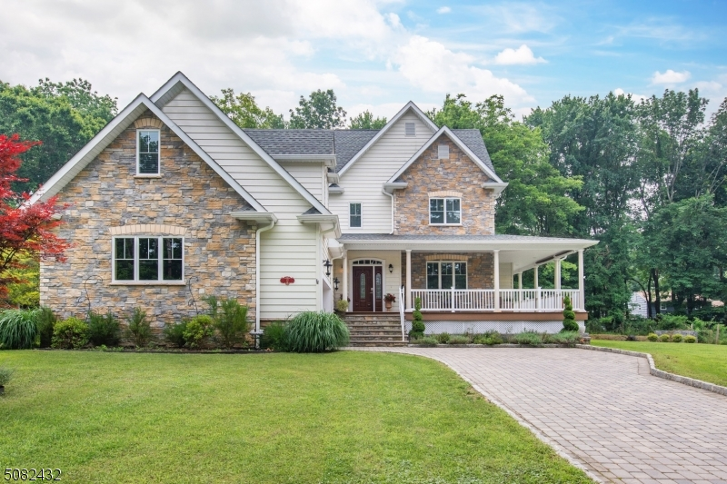 Built in 2016, this engaging, custom colonial with a wrap around porch rests on a beautifully landscaped property with enormous curb appeal providing luxury living at its best.  From the moment you step inside, you are impressed by the foyer entrance, hardwood floors, open flow, and abundant natural light.  The kitchen, dining room, and living room offer an open concept for entertaining.  The kitchen has all the cabinet storage and workspace you need for functionality including stainless steel appliances and a walk-in pantry.  First floor laundry room and office.  Second floor has a fabulous master suite, 3 additional bedrooms and main bath.  Large bonus room over garage.  Huge finished basement features a family room, exercise/recreation space, kitchenette, and half bath.  Get ready to move in and enjoy!
